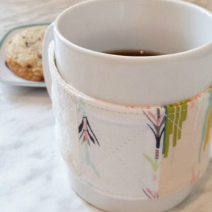 Easy sewing tutorial for a coffee cozy. Quilted fabric cup cozy tutorial. DIY last minute gift idea!