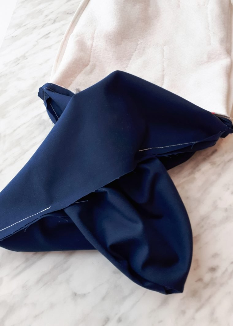 Pull the bag and lining through the gap in the lining.