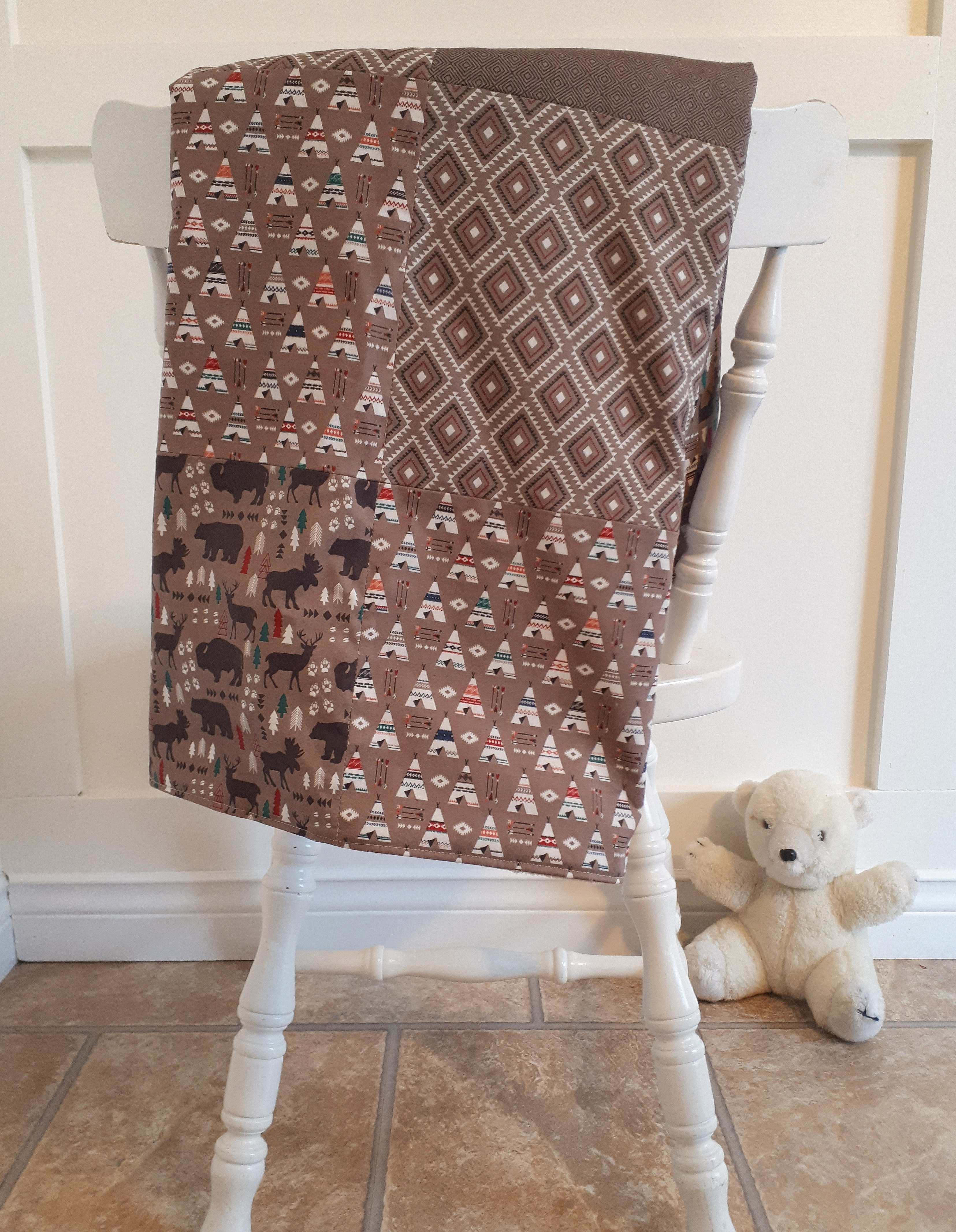 A simple DIY baby blanket tutorial. This sewing project only takes about 2 hours to complete! This patchwork baby blanket would be a great baby shower gift.