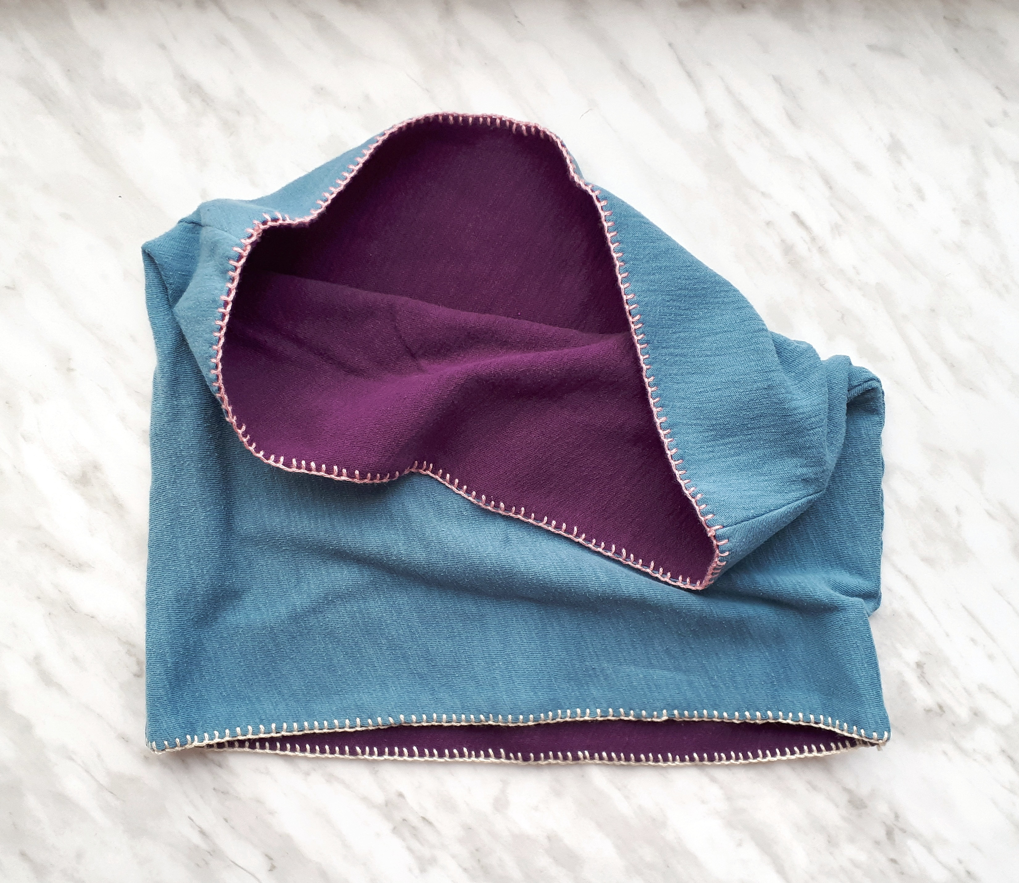 Add a row of blanket stitch to the top and bottom of the cowl