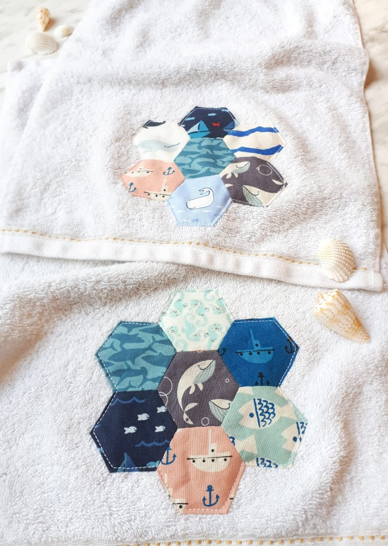 Fabric scrap busting project. Pretty English paper pieced hexagons on an upcycled hand towel. Simple hexie project