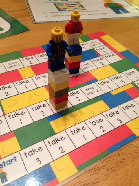 Play a lego board game to practice addition and subtraction