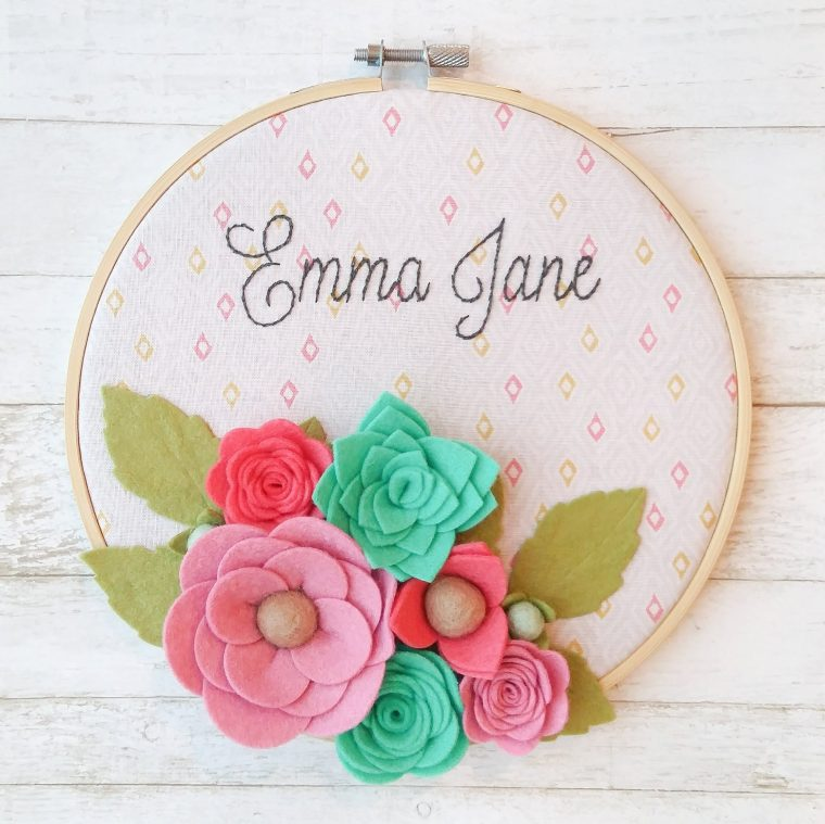 Sweet custom floral hoop art with personalization. Felt flower nursery decor