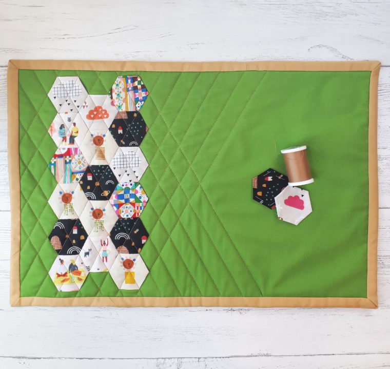 DIY paper pieced hexagon placemat with tutorial.