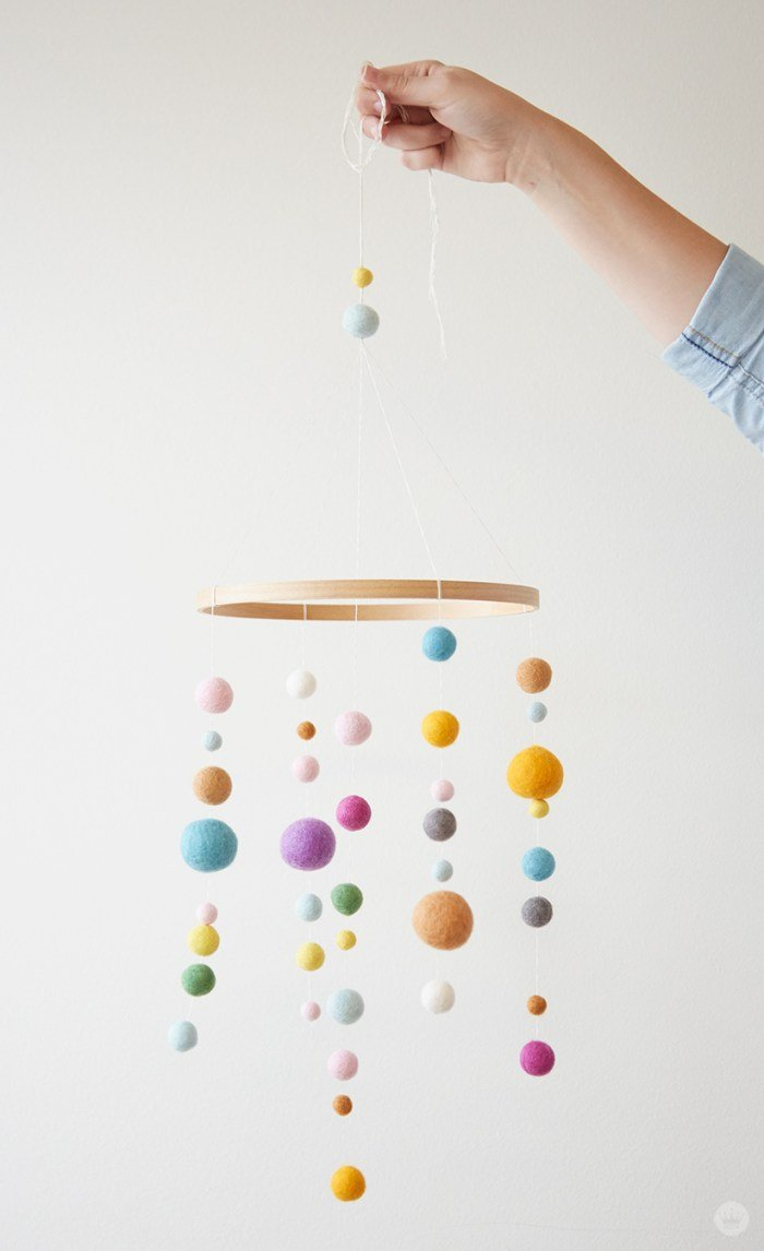 Cute DIY felt ball mobile for a nursery or kids room