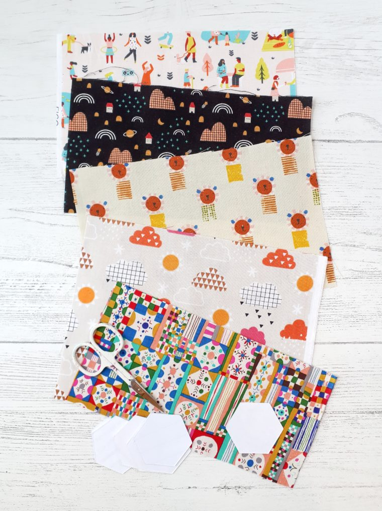 Pick cute fabrics for fussy cutting little hexagons.