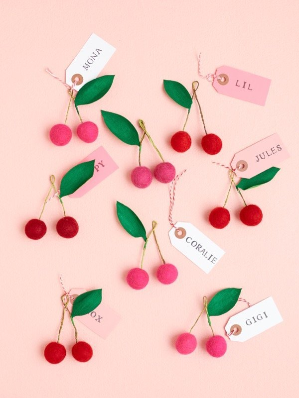 Felt ball cherries that can be used as place cards, gift toppers or party favours. Top 10 DIY felt ball crafts