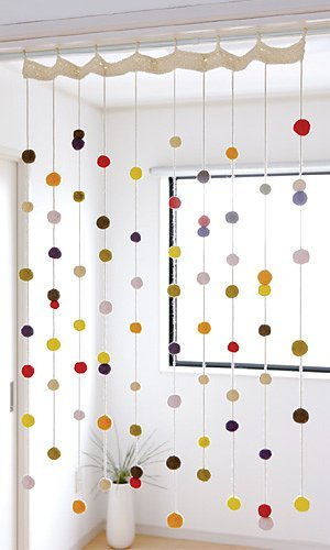 Make a DIY window treatment or door hanging with this crochet pattern and felt balls