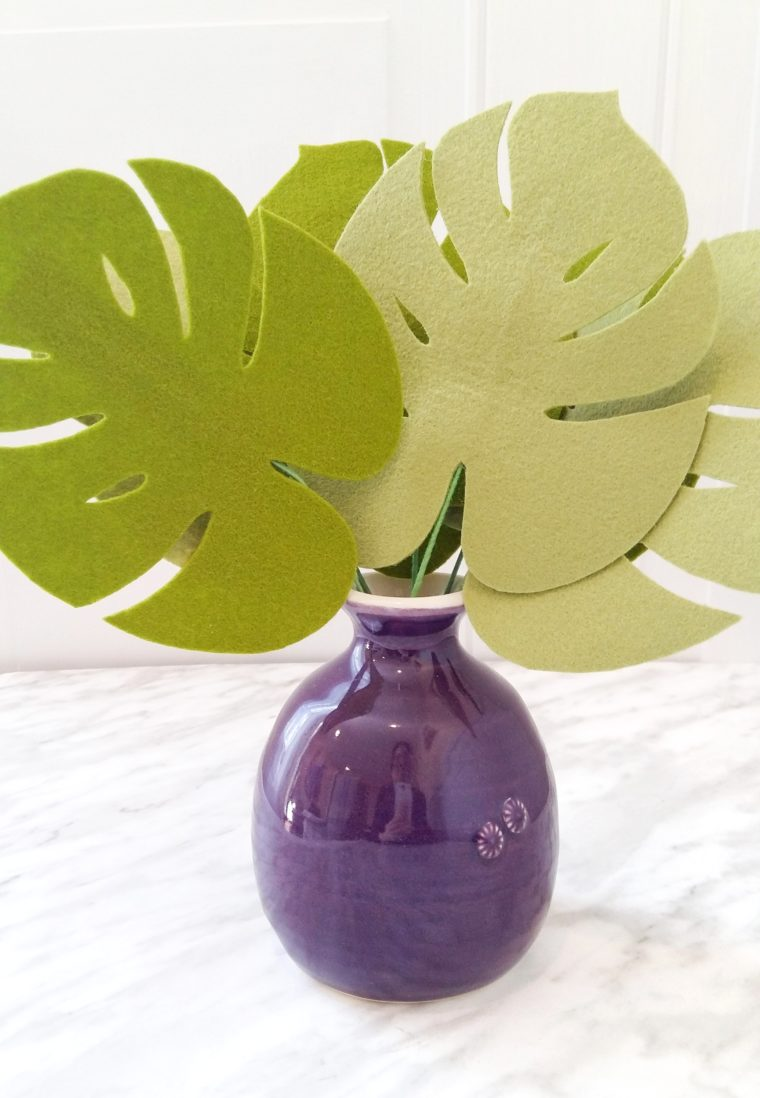 Easy DIY monstera leaves using stiffened felt. Learn how to easily stiffen wool felt in order to add structure to your floral arrangements. DIY felt foliage with free pattern