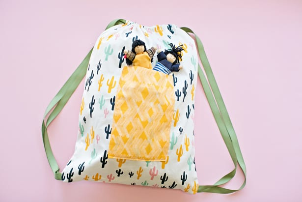 Make a cute drawstring backpack. Simple sewing project ideas for kids.