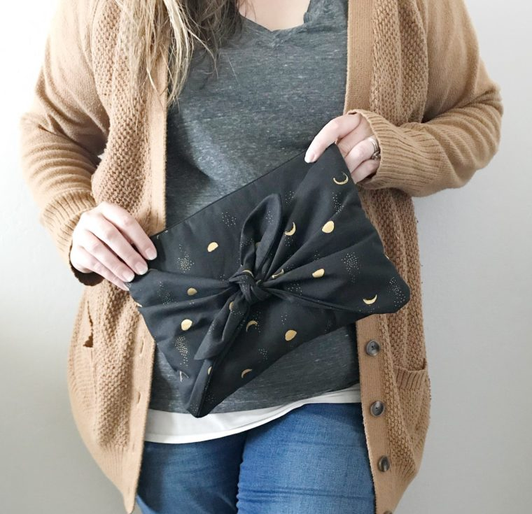 A sweet zippered bow clutch for fun nights out