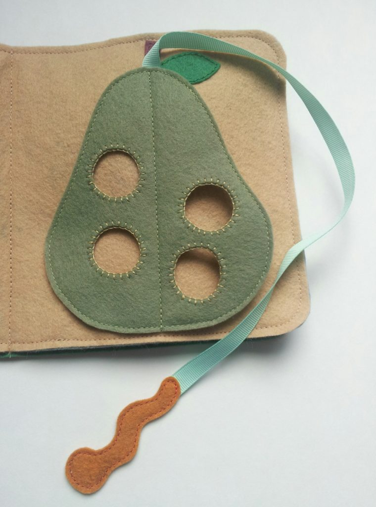 Make a cute caterpillar nibbling on a pear for a quiet book