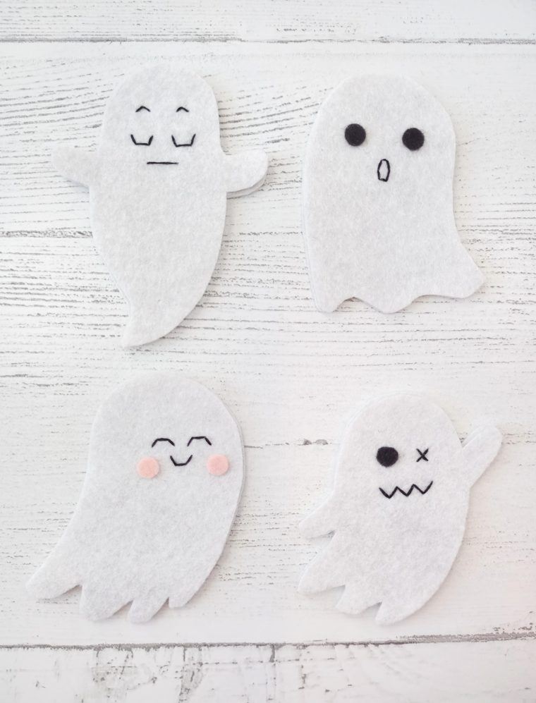 How to embroider on felt ghosts for a DIY Halloween ghost banner.