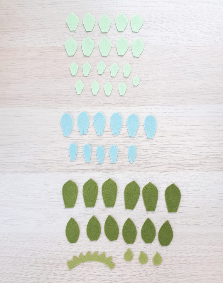 Cutting out all the different leaves for making three different succulents