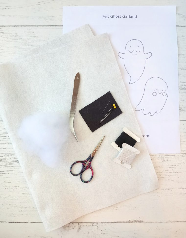 Gather up materials for making a DIY felt ghost banner