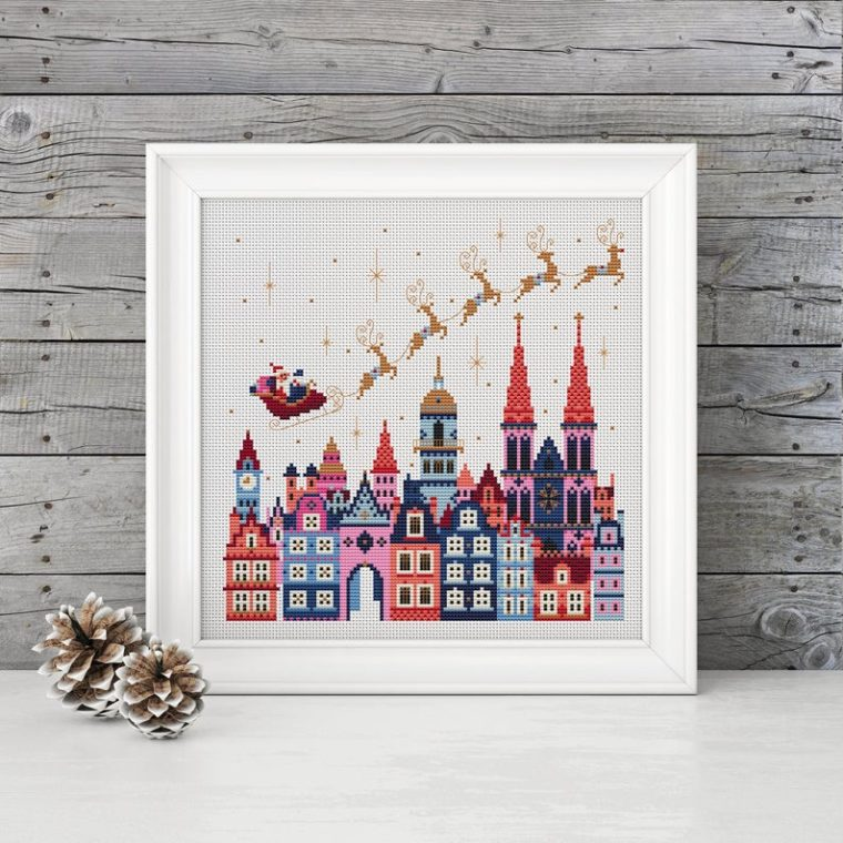 Santa flying overhead. Modern Christmas cross stitch patterns