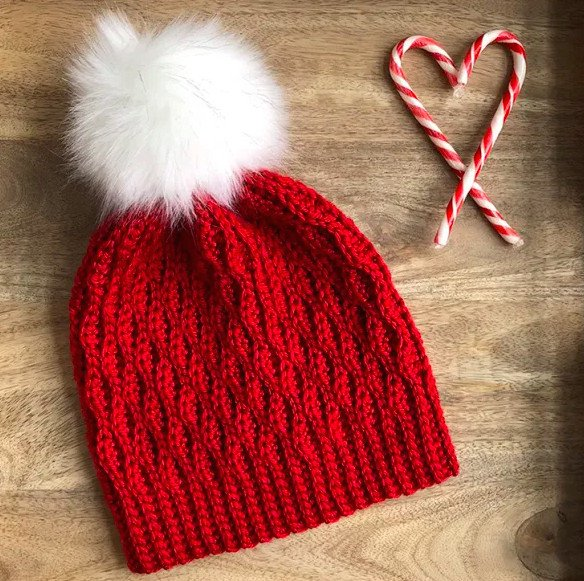 Adorable crochet hat with big white pom pom topper. Amazing DIY Christmas gifts for family to crochet