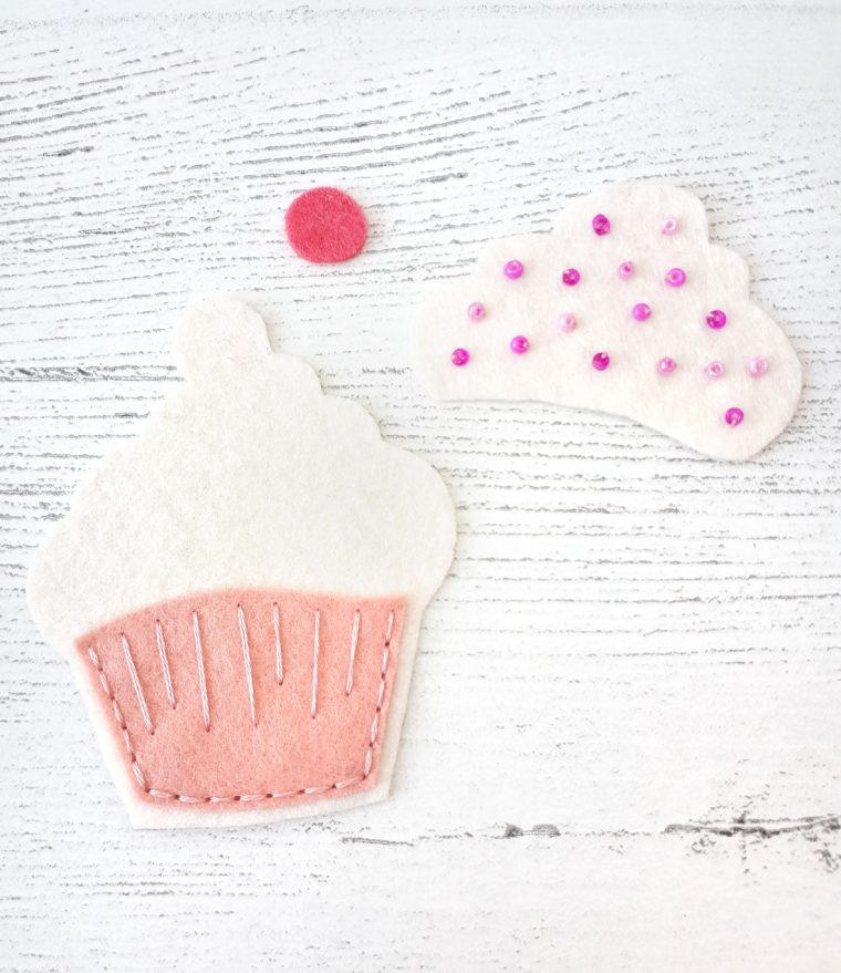 Add some beading and embroidery detailing to the cupcake.