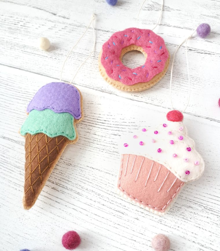 DIY Felt play food ornaments with free patterns. How to make a felt donut. DIY felt ice cream cone ornament. Make a set of cute beaded cupcakes for your little one's play kitchen.