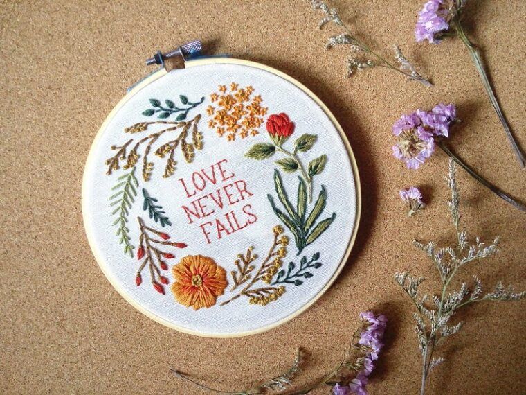 Love Never Fails embroidery. Floral and foliage pattern