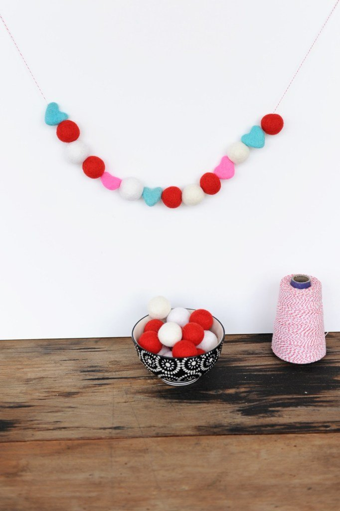 Easy DIY felt ball and heart garland. Simple Valentine's Day decorations to make.
