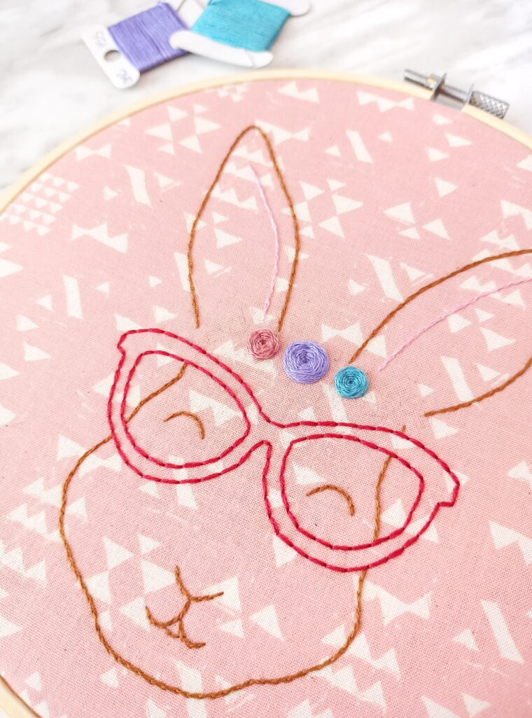How to embroider a woven rose on a cute free bunny pattern.