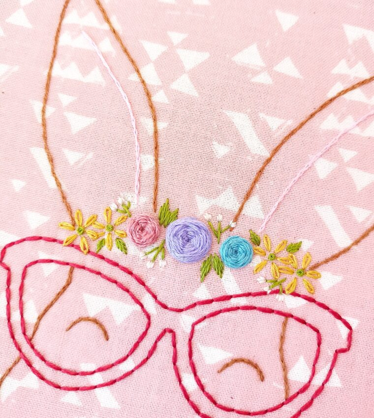 Finish the floral embroidery with tiny white flower buds on this beautiful free bunny embroidery pattern
